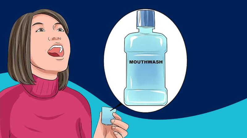 تقویت مینای دندان - با دهان شویه حاوی فلوراید دهانتان را غرغره کنید.
