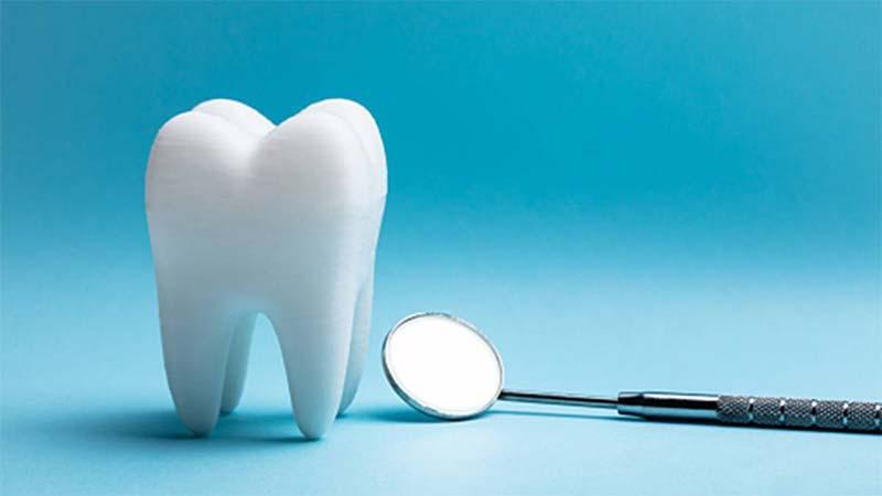 چرا در کامپوزیت دندان از تکنیک لایهبندی استفاده میشود؟